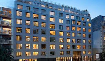 Paris programme immobilier rénové « Rue Petit » en loi pinel